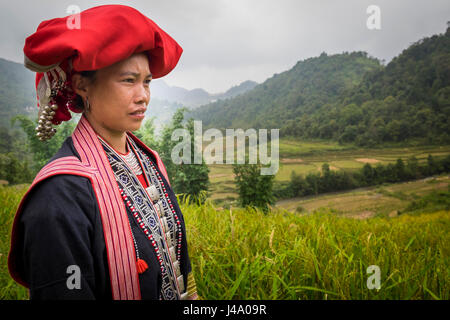 SAPA, VIETNAM - CIRCA SEPTEMBER 2014:  Young woman from the Red Dao minority on the rice fields in Ta Phin Village - Stock Photo
