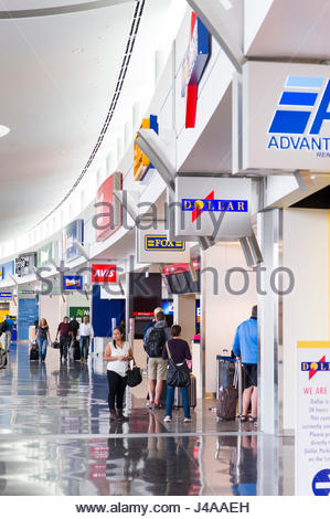 Various rental car companies registration counter in the Seattle-Tacoma International Airport Rental Car Facility, - Stock Photo