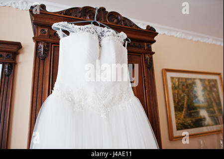 Vintage wedding dress on a hanger Stock Photo: 65508237 - Alamy