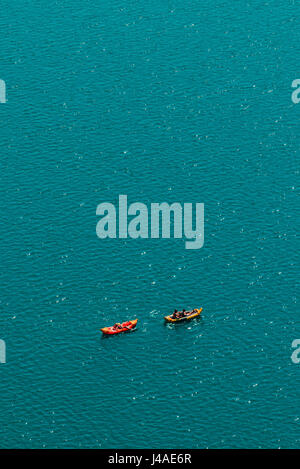 Unrecognizable people enjoying hot summer afternoon in boats on lake Bled, aerial view of leisure and recreational - Stock Photo