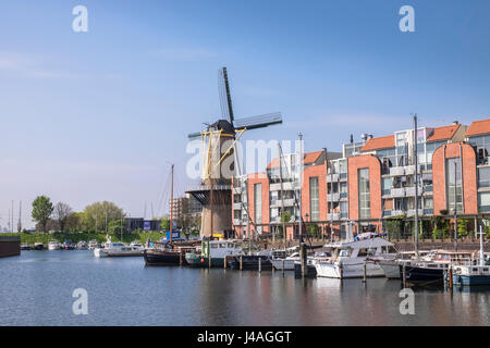 Windmill and boats in the historic area of Delfshaven, Rotterdam, The Netherlands. - Stock Photo