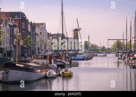Boats moored in the historic area of Delfshaven, Rotterdam, The Netherlands - Stock Photo