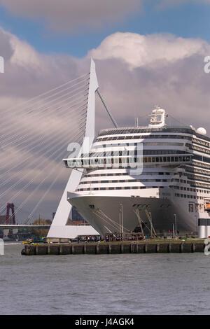 Modern large cruise ship at Wilhelmina Pier, with Erasmusbrug (Erasmus Bridge) in the background, Katendrecht, Rotterdam, - Stock Photo