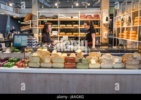 Cheese food stall inside the Markthal indoor food market building, Rotterdam, The Netherlands. - Stock Photo