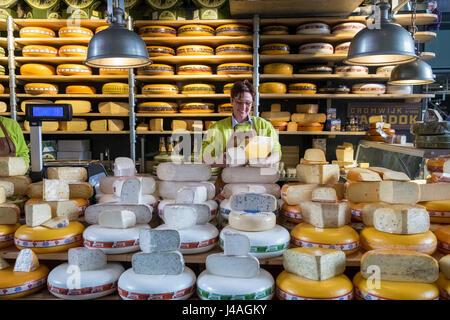 Cheese stall inside Markthal food market, Nieuwstraat, Rotterdam, The Netherlands - Stock Photo