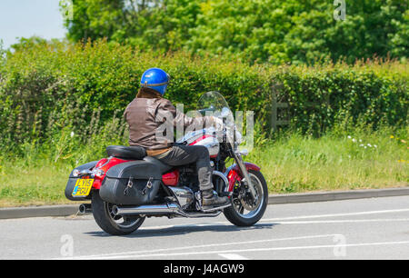 Triumph Thunderbird Commander motorcycle fitted with leather saddlebags. Man riding a Triumph motorbike fitted with - Stock Photo