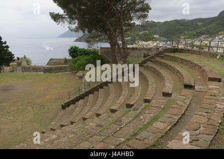 Remains of the theater on a hill in capital of Lipari island in Italy. It dates to Greek period, located on a hill - Stock Photo