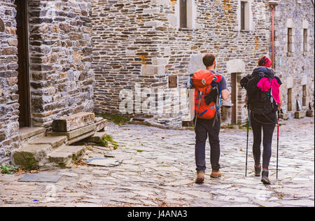 Pilgrims doing the Way of St. James. O Cebreiro. Pedrafita do Cebreiro,Lugo, Galicia, Spain, Europe - Stock Photo