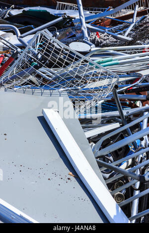 A pile of scrap metal waiting to be recycled - Stock Photo