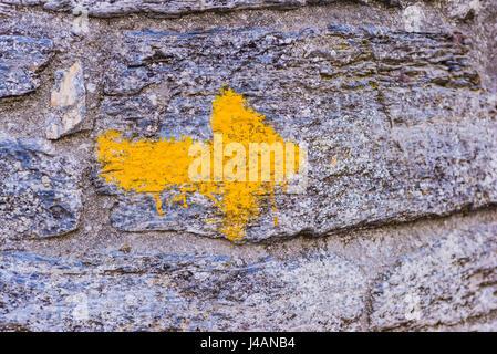 Yellow arrow sign, Way of St. James. O Cebreiro, Pedrafita do Cebreiro, Lugo, Galicia, Spain, Europe - Stock Photo