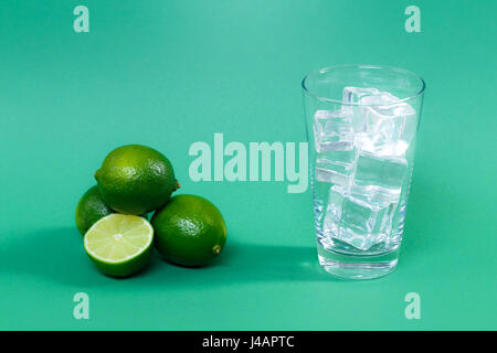 Juicy limes on a green background - Stock Photo