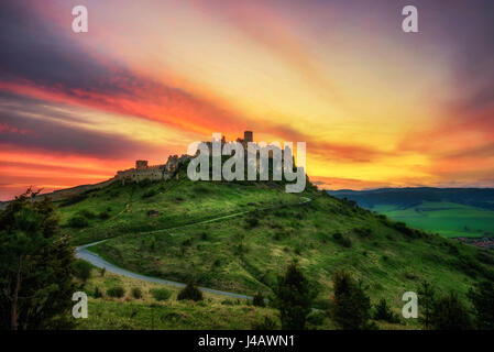 Dramatic sunset over the ruins of Spis Castle in Slovakia.  Spis Castle is a national monument and one of the biggest - Stock Photo