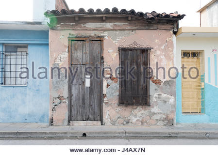Cuban old weathered and worn out architecture. Urban contrast.  Results of economic hardship on real estate. - Stock Photo