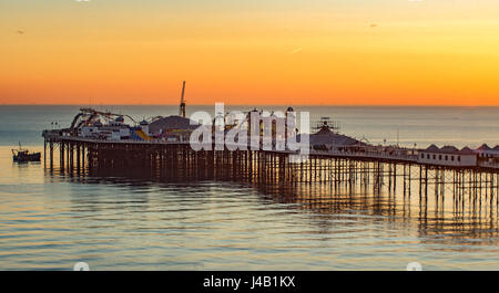 view of Brighton pier at sunset, south of England - Stock Photo