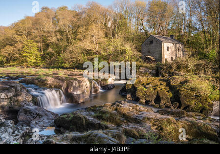 Wide angle long exposure of Cenarth Falls and old water mill, Cenarth, Wales, UK - Stock Photo