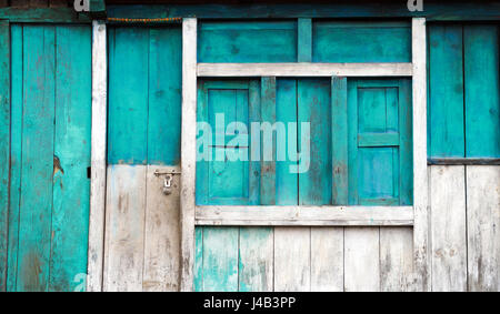 Colorful wooden facade of a simple house in Temang, Annapurna region,Nepal. - Stock Photo