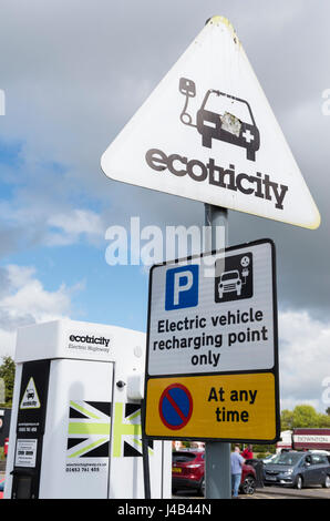 Ecotricity sign at an electric car / vehicle charging point at a service station in the UK - Stock Photo