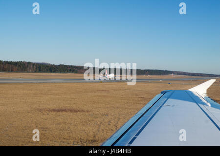 NUREMBERG, GERMANY - JAN 20th, 2017: Aircraft window view of the Nuremberg airport apron, Air Berlin Airbus A320 - Stock Photo