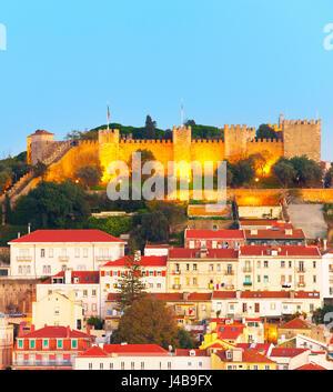 Lisbon Castle on a top of a hill at dusk. Lisbon, Portugal - Stock Photo