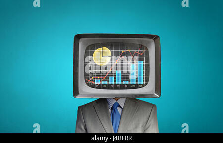 Man with TV instead of head . Mixed media - Stock Photo