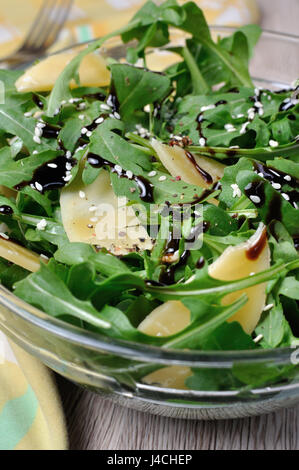 Arugula Rocket Salad Dressed With Balsamic Soy Sauce Parmesan Shavings And Freshly Ground