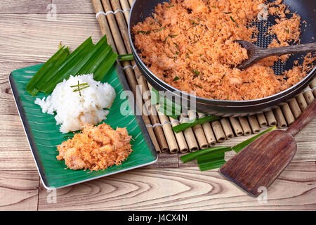 Sticky rice in coconut milk with stir-fried grated coconut and shrimp is popular Thai dessert - Stock Photo