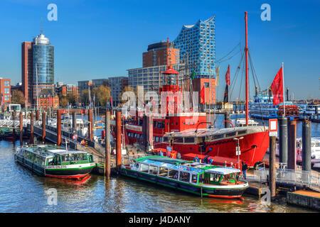 Lightship and Elbphilharmonie in the harbour of Hamburg, Germany, Europe, Feuerschiff und Elbphilharmonie im Hafen - Stock Photo