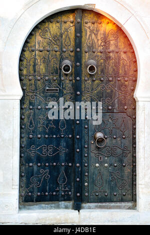 Arched Doorway with Blue Studded Door, Africa, North Africa, Tunisia, Sidi Bou Said - Stock Photo
