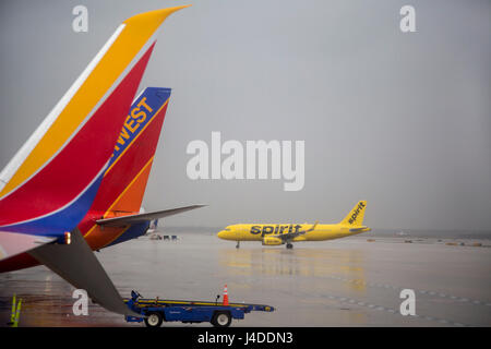 Detroit, Michigan - Spirit and Southwest Airlines planes in a rainstorm at Detroit Metro Airport. - Stock Photo