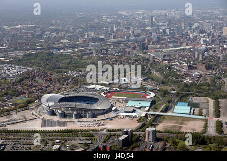 aerial view of Manchester City FC Etihad Stadium with city centre in background - Stock Photo