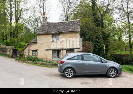 ugly car  in Arlington Row, Cotswold stone cottages, Bibury, Gloucestershire, England, UK - Stock Photo
