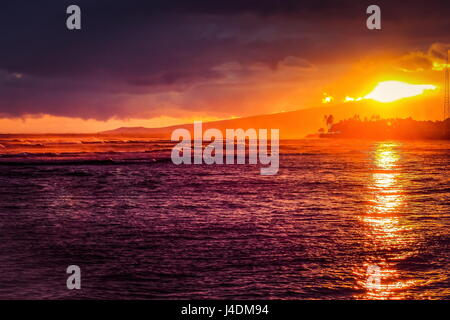 Sunset over Ala Moana Beach, Honolulu, Hawaii on Memorial Day 2016. - Stock Photo