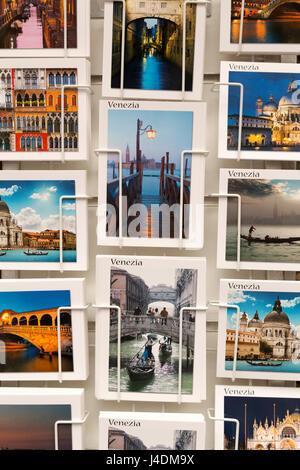 Italy, Venice, tourist souvenir postcards for sale. - Stock Photo