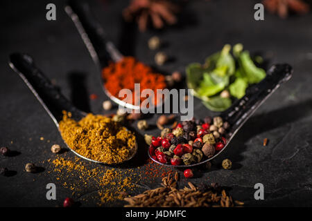 Spice selection on grey slate worktop - Stock Photo