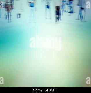 abstract photo of people in motion. Blurred people walking through a city street. - Stock Photo