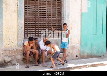 Young cuban kids hanging out in the street. Old Havana, Cuba - Stock Photo