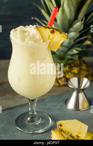 Homemade Frozen Pina Colada Cocktail with a Pineapple Garnish - Stock Photo