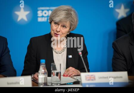 British Prime Minister Theresa May addresses delegates during the opening of the London Somalia Conference at the - Stock Photo