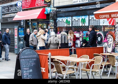 Queue of people waiting in line at the start of Record Store Day 2017 at Flashback Records, Essex Road, London, - Stock Photo
