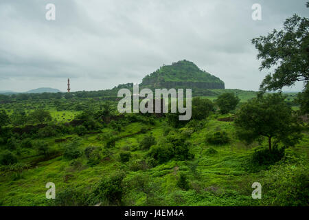 A wide shot of the Daulatabad Fort with Chand Minar visible, near Aurangabad in India - Stock Photo