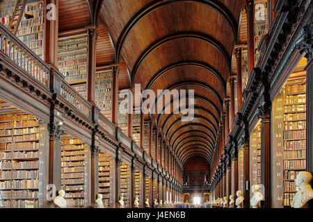 The Long Room in the library of Trinity College, Dublin, Republic of Ireland, Europe - Stock Photo