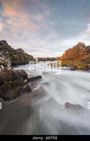 Oxararfoss River at sunrise, Thingvellir National Park, UNESCO World Heritage Site, Iceland, Polar Regions - Stock Photo