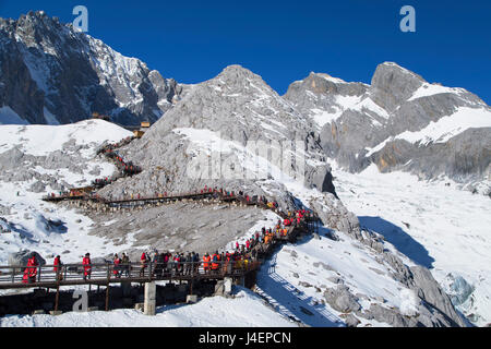 Tourists on Jade Dragon Snow Mountain (Yulong Xueshan), Lijiang, Yunnan, China, Asia - Stock Photo