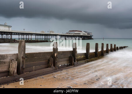 A stormy sky over the beach and pier at Cromer, Norfolk, England, United Kingdom, Europe - Stock Photo