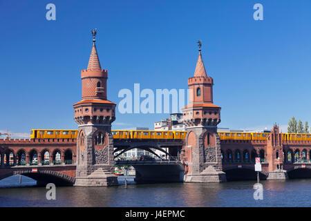 Oberbaum Bridge between Kreuzberg and Friedrichshain, Metro Line 1, Spree River, Berlin, Germany, Europe - Stock Photo