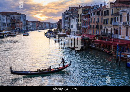 Gondola on the Grand Canal at sunset in winter, from Rialto Bridge, Venice, UNESCO World Heritage Site, Veneto, - Stock Photo