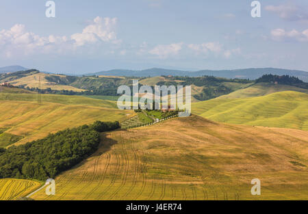 Green rolling hills and farm houses of Crete Senesi (Senese Clays), Province of Siena, Tuscany, Italy, Europe - Stock Photo