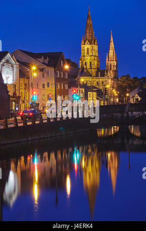 A dusk view of St. Fin Barre's Cathedral, on the banks of the Lee River, in Cork, County Cork, Munster, Republic - Stock Photo