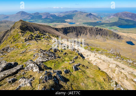 On the Rhyd Ddu path approaching the summit of Snowdon showing Bwlch Main and Llechog with the Nantle hills in the - Stock Photo