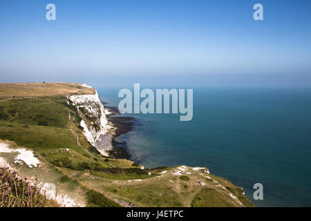The white cliffs of Dover on a sunny blue sky day. - Stock Photo